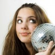Young woman holding a disco ball — Stock Photo #1550582