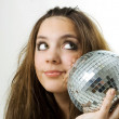 Young woman holding a disco ball — Stock Photo