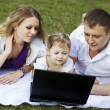 Royalty-Free Stock Photo: Family on picnic with laptop
