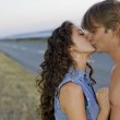 Couple kissing at the edge of road — Stock Photo