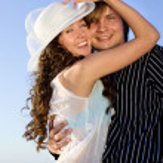 Couple having fun near sea — Stock Photo
