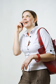 Laughing girl talking on mobile phone — Stock Photo