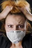 Frighten woman wearing face mask — Stock Photo