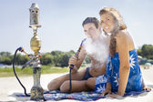 Couple smoking hookah — Stock Photo