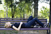 Woman relaxing on a bench — Stock Photo