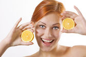 Beautiful girl with juicy lemons — Stock Photo