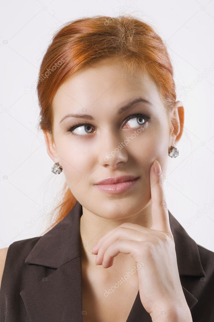 Beautiful young woman thinking, finger near face — Stock Photo #1615292