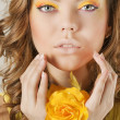 Beautiful woman with yellow flower — Stock Photo