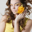 Fashion model posing with rose - Stock Photo
