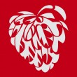 Angel's heart on red — Stock Photo