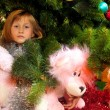 Cute girl and Christmas Tree — Stock Photo