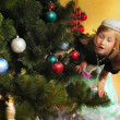 Cute girl and Christmas Tree — Stock Photo #1523802