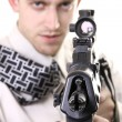 Young purposeful manager with gun — Stock Photo