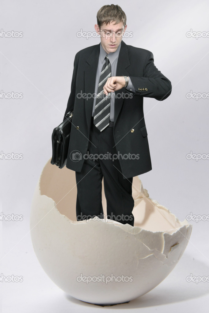 Young businessman looks out from big egg — Stock Photo #1523768