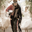 Постер, плакат: Pretty hussar in vintage outfit is escaping from brides Retro styled photo