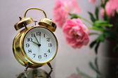 Golden alarm clock — Stock Photo