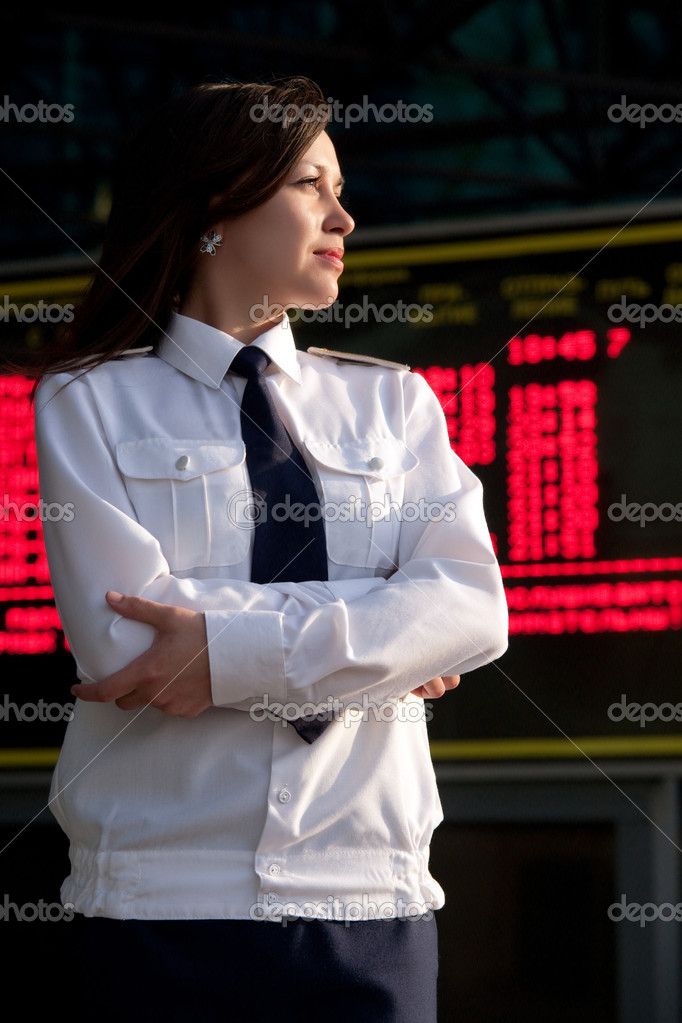 Portrait of the airhostess in the uniform on the blurred background. — Stock Photo #1229165