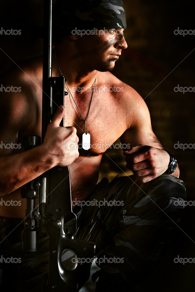 Powerful sniper with the rifle is thinking about war — Stock Photo #2186879