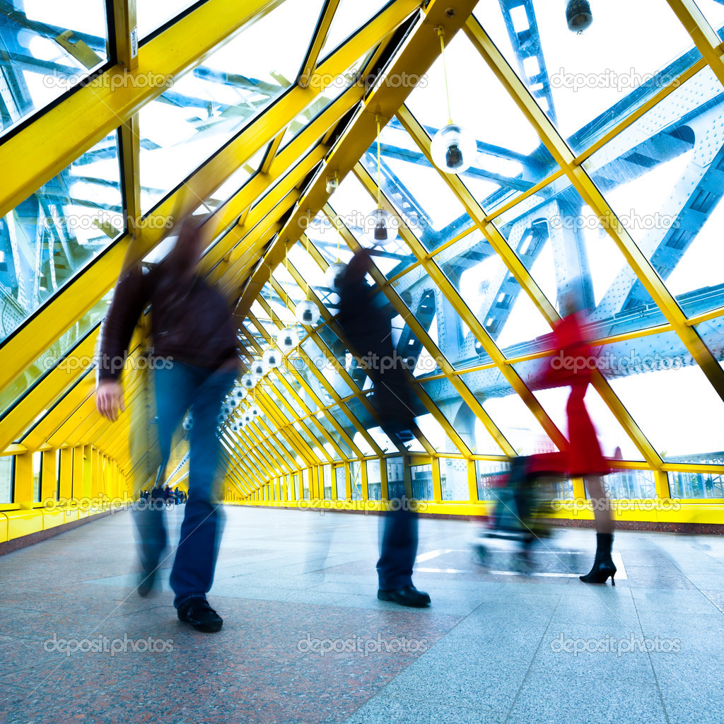 Silhouettes in motion in yellow passage, square composition — Stock Photo #1187449