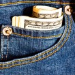 Stock Photo: Jeans pocket with many one hundred dolla