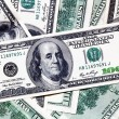 One hundred dollar banknotes background — Stock Photo