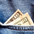 Jeans pocket and two ten dollars banknot — Stock Photo