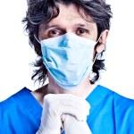 Surgeon in gloves — Stock Photo