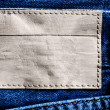 Denim background with label — Stock Photo