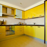 Yellow kitchen interior — Stock Photo