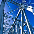 Blue metal suspended bridge construction - Stock Photo