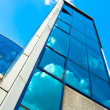 Stock Photo: Crop of blue glass wall of skyscraper