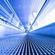 Royalty-Free Stock Photo: Escalator view in blue corridor