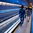 Blue moving escalator with — Stock Photo