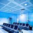 Chairs in blue airport hall — Stock Photo #1288946