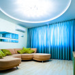 Modern blue room with TV and sofa — ストック写真