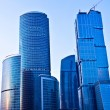Blue modern skyscrapers in business cent — Stock Photo