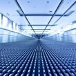 Escalator view in blue corridor - Stock Photo