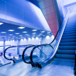 Escatator in blue hall - Stock Photo