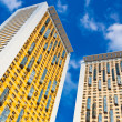 New yellow dwelling towers with balconie — Stock Photo