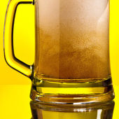 Mug of lager beer with bubles — Stock Photo