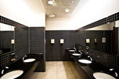 Empty restroom interior with washstands, — Stock Photo