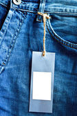 Jeans background crop with blank label — Stock Photo