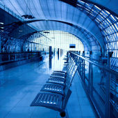 Interior of blue airport with seat — Stock Photo