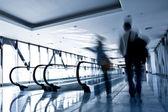 Move in glass corridor — Stock Photo