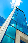Crop of blue glass wall of skyscraper — Stock Photo