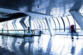 Person move in modern glass corridor — Stock Photo