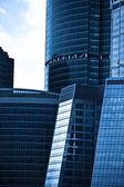 Crop of dark blue modern skyscrapers — Stock Photo