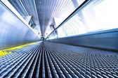 Camera is lying on escalator — Stock Photo