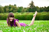 Lying pretty smiling girl — Stockfoto