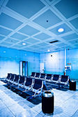 Chairs in blue airport hall — Stock Photo